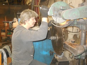 guy looking at saw blade